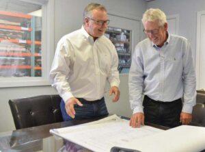 team members looking at plans